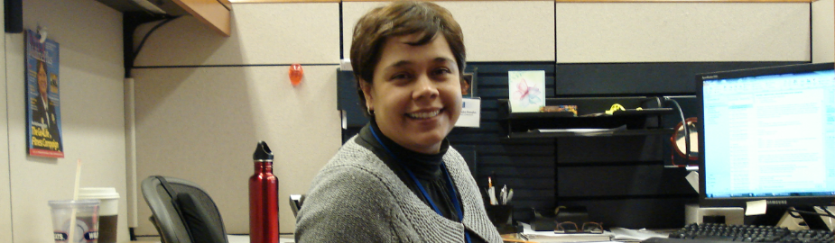 Diana Almader-Douglas, NLM Associate Fellow 2012-2013 at her cubicle.