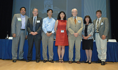Photo of Atul Butte, Stanford University; John Glaser, Siemens Healthcare; Xinghua Lu, University of Pittsburgh; Hong Yu, University of Wisconsin-Milwaukee; Ted Shortliffe, AMIA (moderator); Joan Ash, OHSU; and Jim Cimino, NIH Clinical Center.