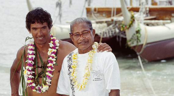Nainoa Thompson of the Polynesian Voyaging Society stands next to Micronesian wayfinder, Mau Piailug.