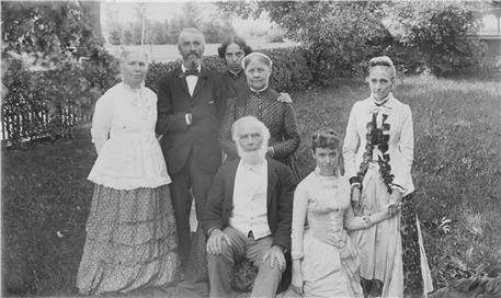A group portrait of seven people.