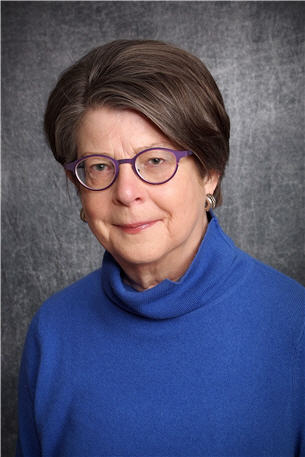 A photograph headshot of a woman (Anne Flitcraft, MD)