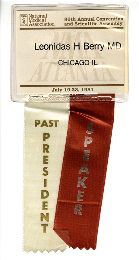 Dr. Berry's plastic name tag with two ribbons hanging from it to signify his past president and speaker.