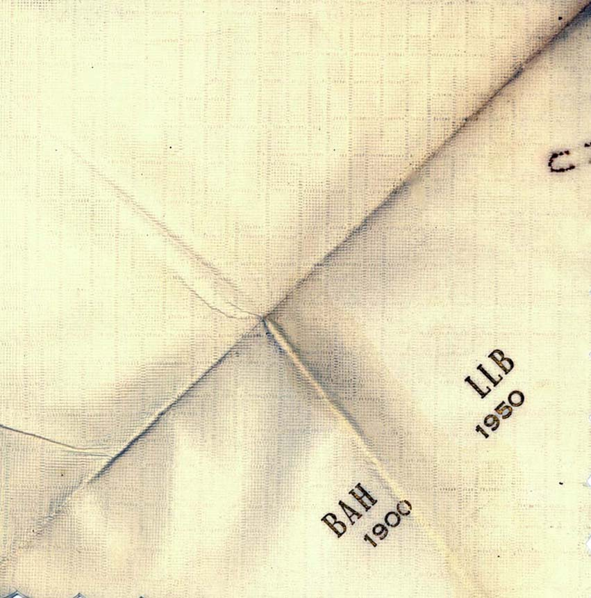 White square napkin with the initials BAH 1900 and LLB 1950.