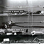 A display case showing name plates for Leonidas H. Berry,  scopes, and other medical instruments.