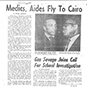 Page with typewritten text and photo of two African American men.