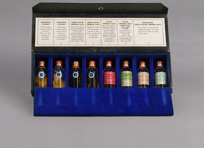 Rectangular sales kit opened showing a row of eight glass vials.