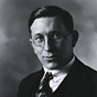 Black-and-white photo of F. G. Banting wearing round glasses, a tie, vest, and jacket.