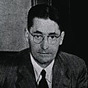 Black-and-white photo of Florey at a desk up which there are some papers