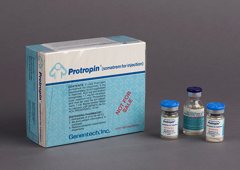 Box and three small labeled vials of Protropin.