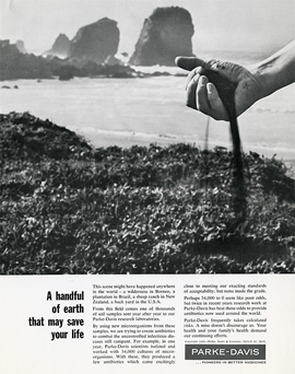 Magazine ad featuring a photograph of a hand grabbing dirt and particles spilling out back onto a beach.