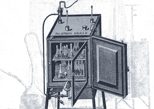 Drawing of an incubator with its door open to show flasks and culture tubes inside.