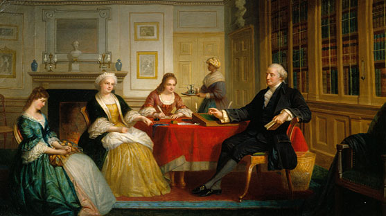 Washington Family dressed formally sitting beside a table in a room with a fireplace and bookshelf.