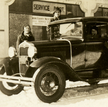 4 White female nurses around a Ford Model A Coupe at East 200th Street with snow in the Bronx.