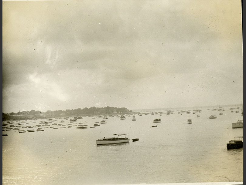 Many boats moored in the water near City Island.