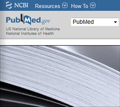 PubMed home page with a close-up of pages in a book.