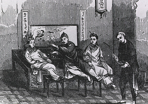 Four Chinese men in traditional dress smoke opium on a bench.