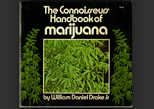 Photograph of a Book with marijuana plants on the cover.