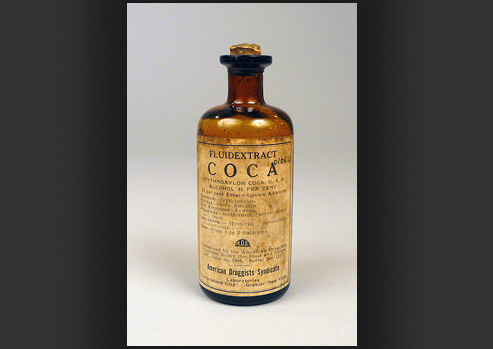 Photograph of a bottle with coca extract.