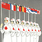 Eight White female Red Cross nurses, each holding flags from a different WWI Allied Entente country.