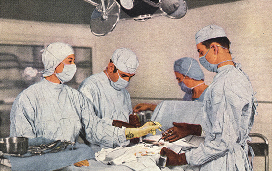 Two White male doctors and two White female nurses in the middle of an operation.