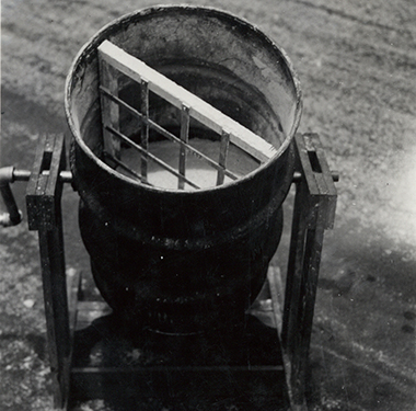 A metal drum with a stirring paddle