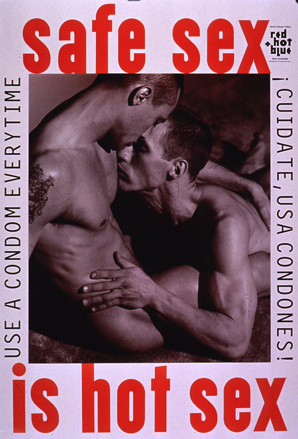 Predominantly white poster with black and orange lettering. Initial title words at top of poster. Publisher information, along with an advertisement for a video, in upper right corner. Visual image is a black and white photo reproduction featuring a male-male couple kissing. Remaining title text below photo. English caption of left side of poster; Spanish caption on right.
