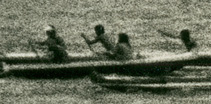 People rowing a canoe