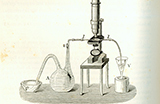 Black and white image of a beaker, microscope and bowl