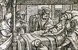 Sick patient in bed surrounded by on-lookers