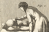 Image of woman attending to a body