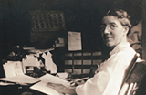 Historical photograph of Charlotte Perkins Gilman at her desk