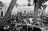 Photograph of a crowded encampment