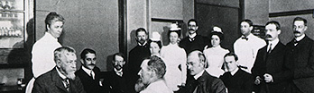Black and white historical photograph of people gathered together