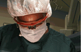 Close-up photograph of an African American surgeon performing surgery
