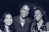 Dr. Joan Y. Reede, an African American woman, center, posing with two women