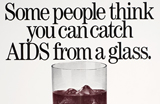 Image of glass, with text reading 'Some people think you can catch AIDS from a glass'