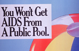 Image of beach ball with text reading 'You Won't Get AIDS From A Public Pool'