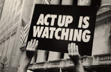 Photograph of sign reading 'ACT UP IS WATCHING'