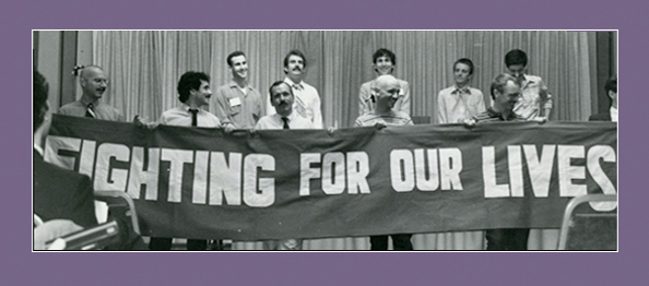 Group of men holding a banner reading 'Fighting for our Lives'