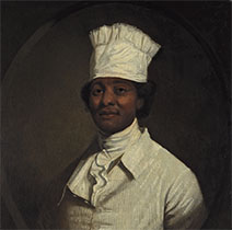 A portrait of a black man wearing a white shirt, vest, cravat, and hat.