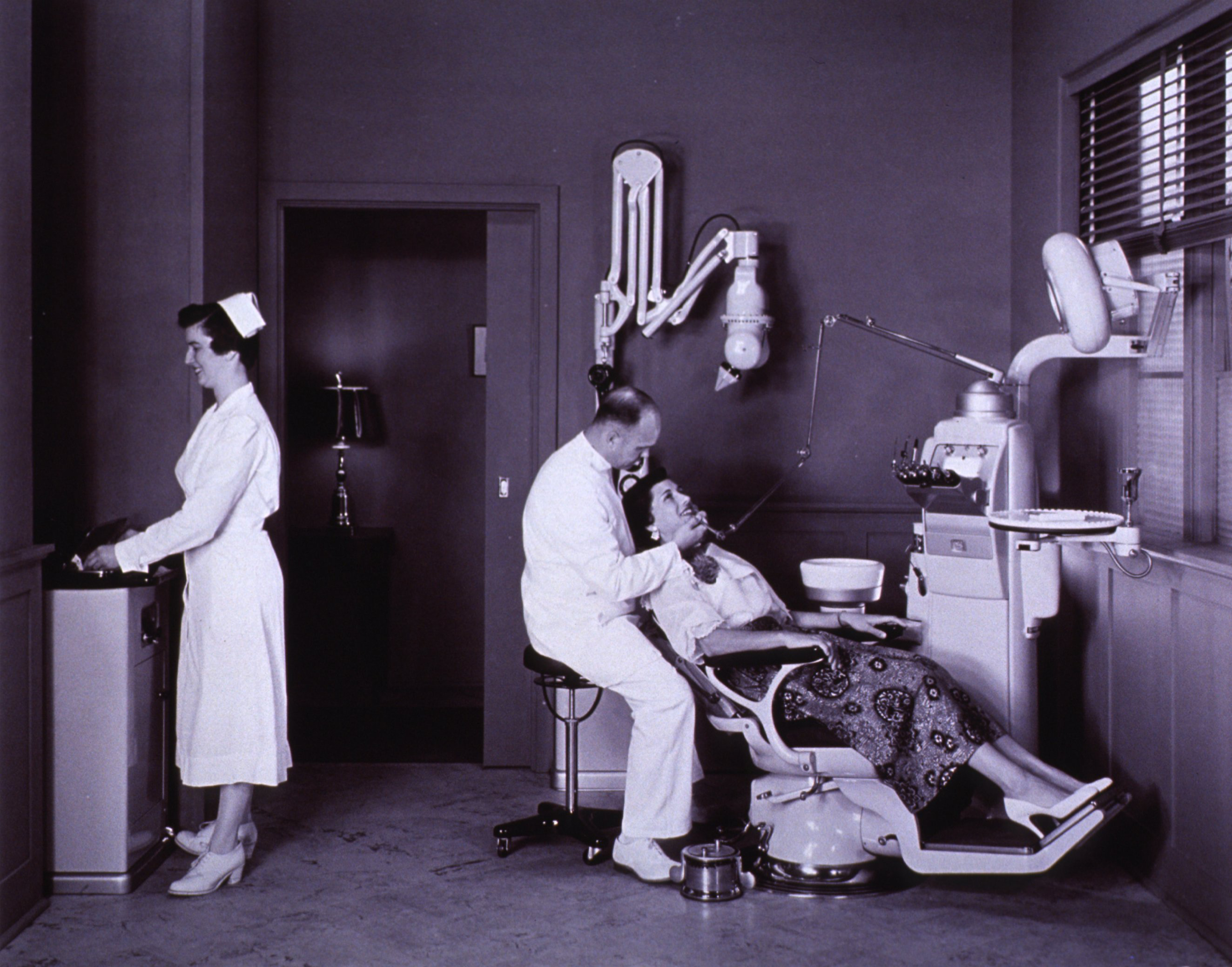 Ritter chair, dental unit, and x-ray machine. A dentist, sitting on a ...