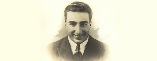 A formal photograph of a young DeBakey in a suit.