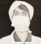 A newspaper photo of a nurse in a surgical mask.