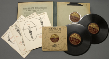 A sample miniature record and chart featuring 'the grasp' and a personal development chart with overlays describing the beneficial effects of the twelve exercises.