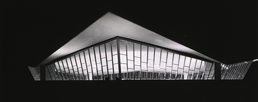 The roof of the National Library of Medicine at night.