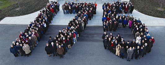 Staff stand in front of NLM in the shape of the numbers 175 for an anniversary celebration.