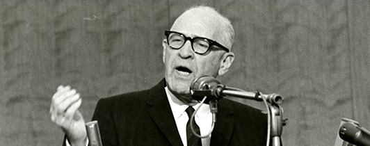 A man speaks at a podium.
