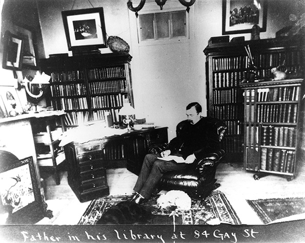 Photograph of man sitting on a chair in a living room.