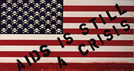 American Flag with lowest red bar dripping blood and the stars as skull and crossbones. Text overlay: AIDS is still a crisis.