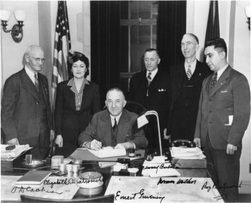 Governor Gruening (Seated) Signs the Anti-Discrimination Act of 1945